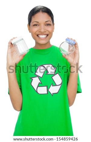 Cheerful model wearing recycling tshirt holding pots on white background - stock photo