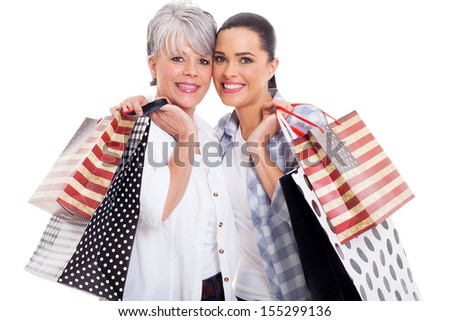 cheerful mother and adult daughter carrying shopping bags isolated on white - stock photo