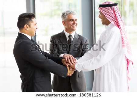 cheerful multicultural business partners teamwork