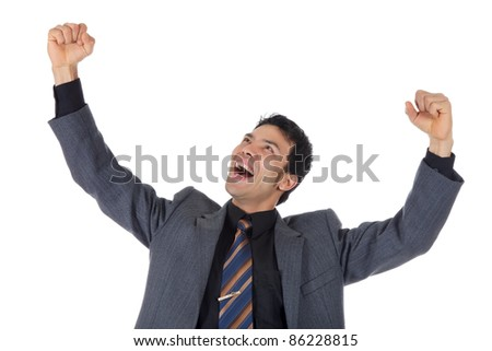 Cheerful nepalese businessman, young winner who is celebrating his victory. Studio shot. White background. - stock photo