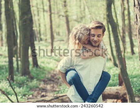 cheerful pair of lovers in summer forest - stock photo