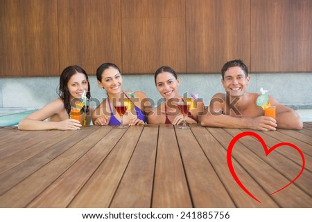 Cheerful people with drinks in swimming pool against heart - stock photo