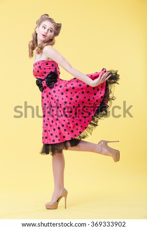 Cheerful pin-up girl is flirting with you - stock photo