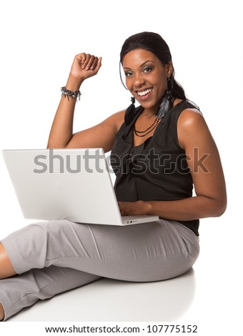 Cheerful Plus Size Businesswoman Working on Laptop Computer Sitting Isolated on White Background - stock photo