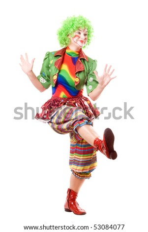 Cheerful posing female clown. Isolated on white