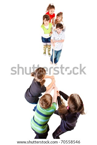 Cheerful preschooler teams pulling rope, over white - stock photo