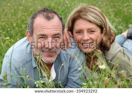 Cheerful retired couple relaxing in countryside