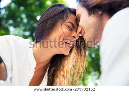 Cheerful romantic couple outdoors - stock photo