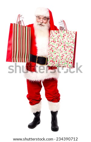Cheerful santa claus shopping for x-mas gifts - stock photo