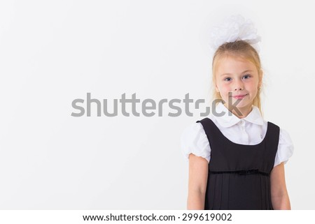 Cheerful school girl standing, isolated - stock photo