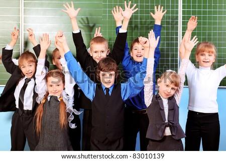 Cheerful schoolchildren at a classroom. Education. - stock photo