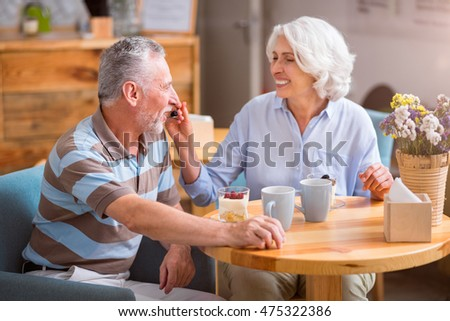 Cheerful senior couple resting in the cafe
