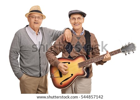 Cheerful seniors playing a guitar isolated on white background