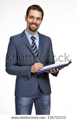 Cheerful smiling businessman writing on clipboard isolated over - stock photo