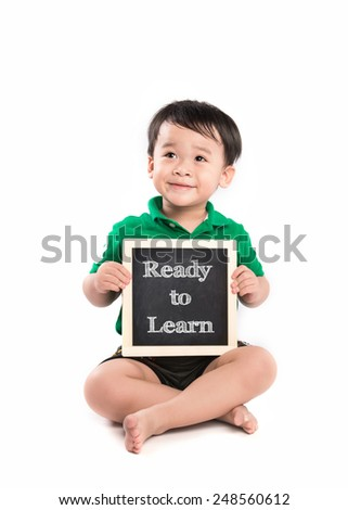 Cheerful smiling little asian boy on a white background. Looking at something. School concept. Happy child holding black board. Isolated. Read to Learn - stock photo