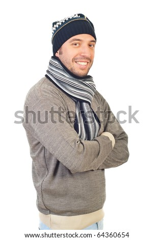 Cheerful smiling man in winter knitted clothes standing with arms folded isolated on white background