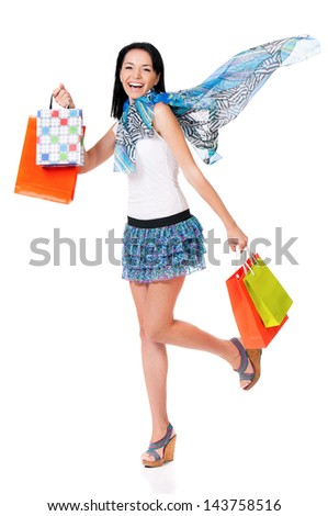 Cheerful smiling woman with shopping bags, isolated over white background