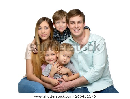 Cheerful smiling young family of five enjoying time together and looking at camera. Isolated on white background. Concept for happy family - stock photo