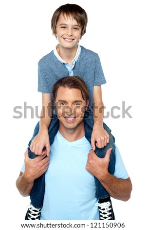 Cheerful son enjoying a piggyback ride on his father's shoulder. Studio shot. - stock photo