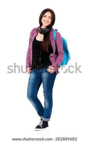 Cheerful student girl with backpack and black headphones, isolated on white background - stock photo