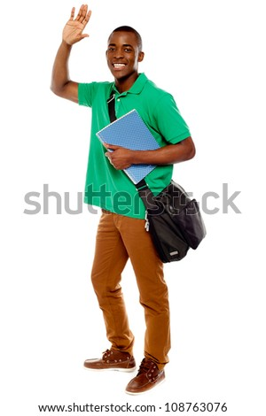 Cheerful student waving his hands. Enjoying himself. all on white background - stock photo