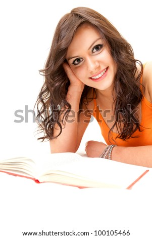 cheerful student young woman with book looking at camera, white background