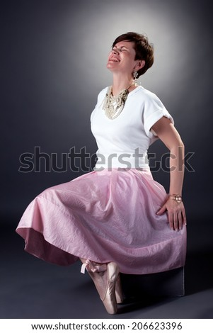 Cheerful stylish woman posing in pointes - stock photo