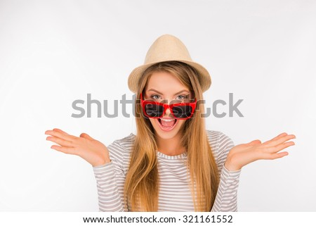 cheerful surprised girl with a hat and glasses - stock photo