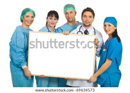 Cheerful team of five doctors holding a blank banner isolated on white background - stock photo