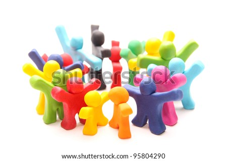 cheerful team of plasticine guys standing in a circle ready for their war cry - stock photo
