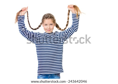 Cheerful teen girl in bright casual clothes holds her long braids. Hair, haircare. Studio shot. Isolated over white. - stock photo