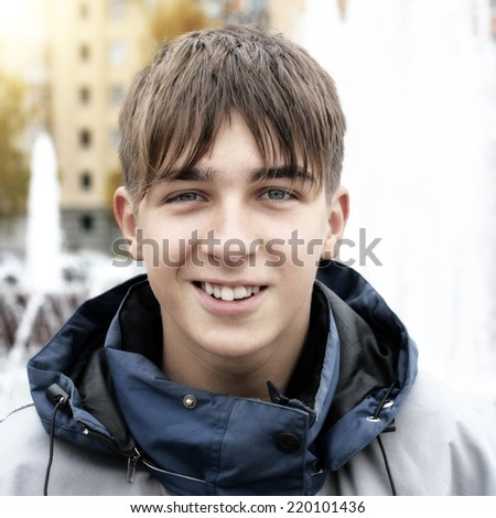 Cheerful Teenager Portrait in the City - stock photo