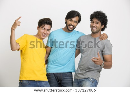 Cheerful three young friends happy - isolated over white background. - stock photo