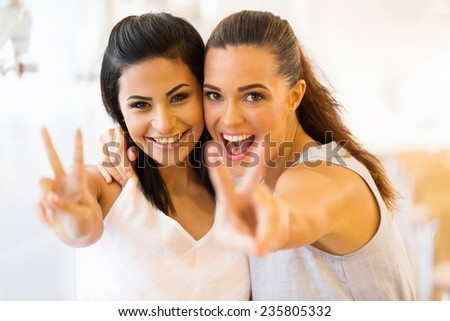 cheerful two young friends having fun - stock photo