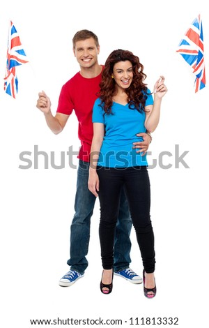 Cheerful UK supporters posing together. Cheering for nation - stock photo