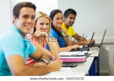 cheerful university students in lecture hall