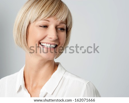 Cheerful woman against grey background - stock photo