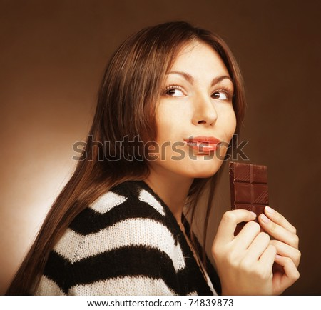 Cheerful woman eating chocolate