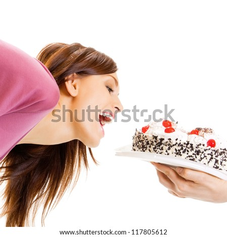 Cheerful woman eating pie, isolated over white background - stock photo