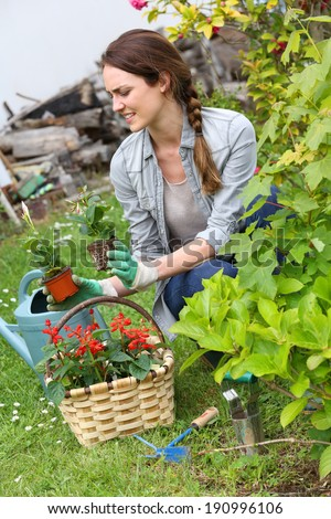Cheerful woman gardening at home in springtime