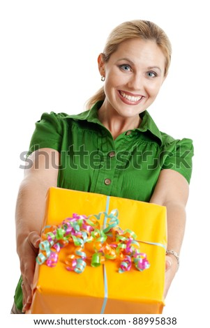 Cheerful woman giving a present isolated on a white background - stock photo