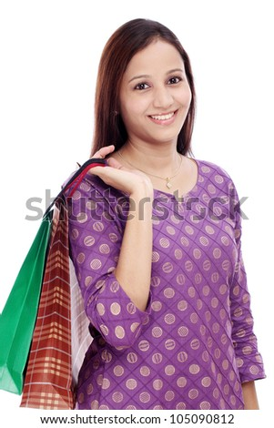 Cheerful woman holding shopping bags against white background