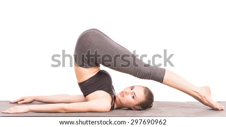 Cheerful woman in a traditional yoga pose at studio. - stock photo