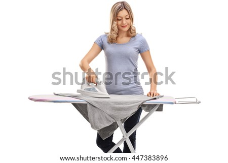 Cheerful woman ironing clothes and smiling isolated on white background - stock photo