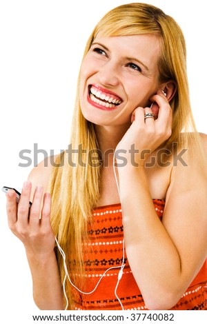 Cheerful woman listening to music on MP3 player isolated over white - stock photo