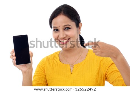Cheerful woman pointing finger on smartphone screen isolated on a white background - stock photo