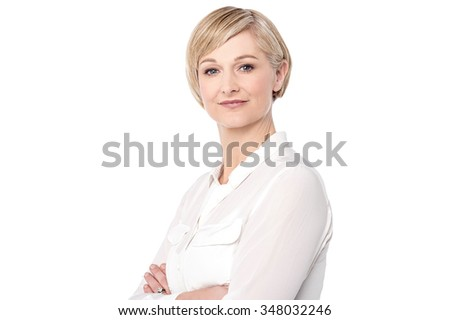 Cheerful woman posing confidently to camera - stock photo