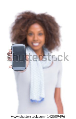 Cheerful woman showing her smartphone on white background - stock photo