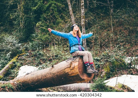 Cheerful woman traveler on vacation camping summer vacations outdoor. Forest in the highlands. Hiking Travel Lifestyle concept summer vacations. - stock photo
