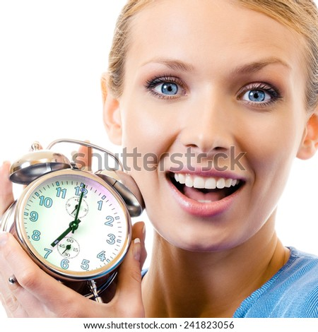 Cheerful woman with alarmclock, isolated over white background - stock photo